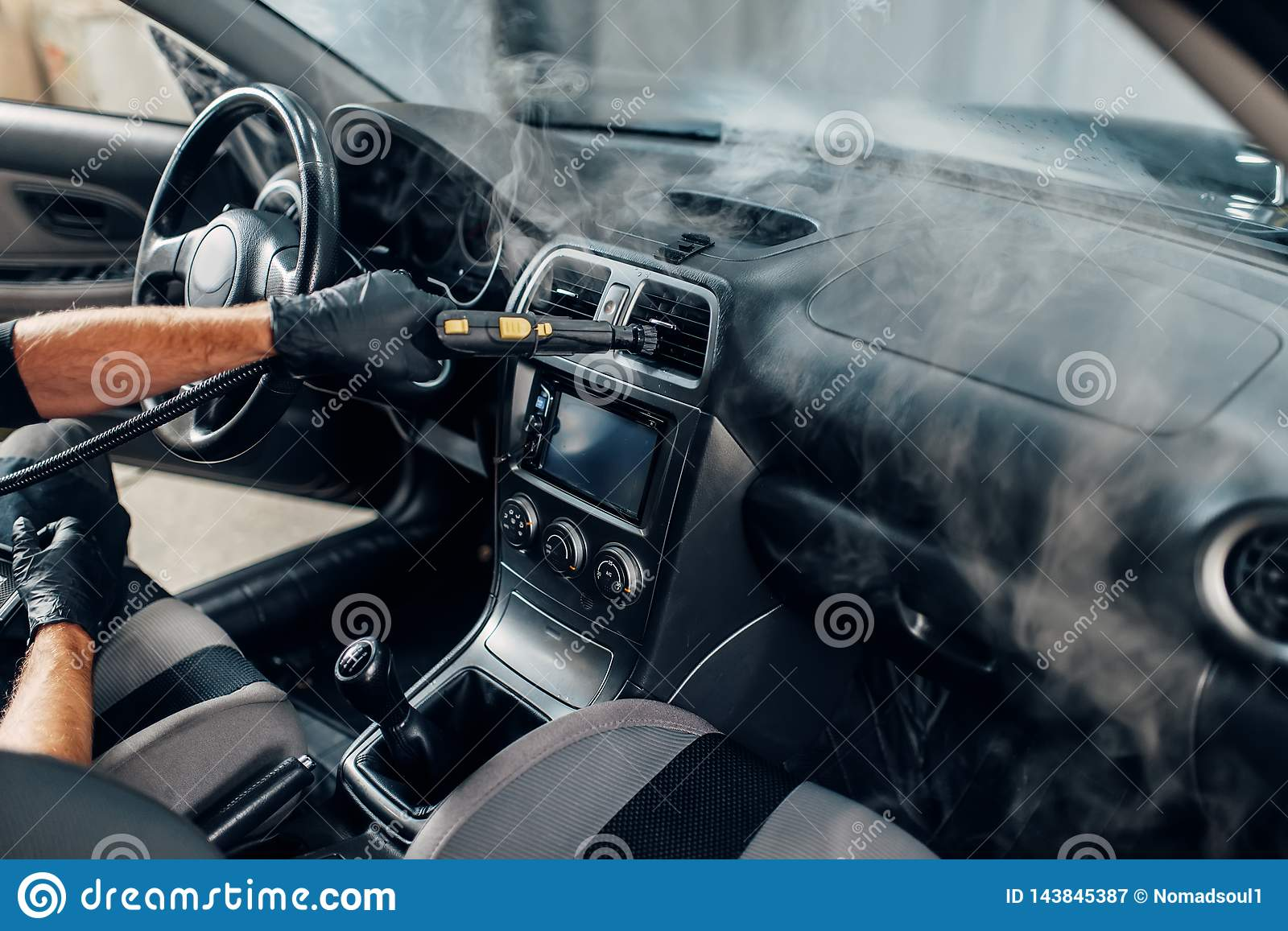 Steam Clean Car Interior >> Carwash Worker Cleans Salon With Steam Cleaner Stock Image