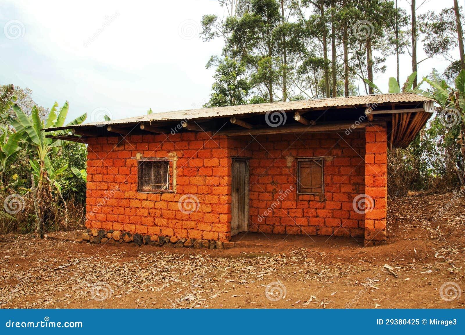 Casa africana feita de tijolos vermelhos da terra foto de for Piani casa africani gratis