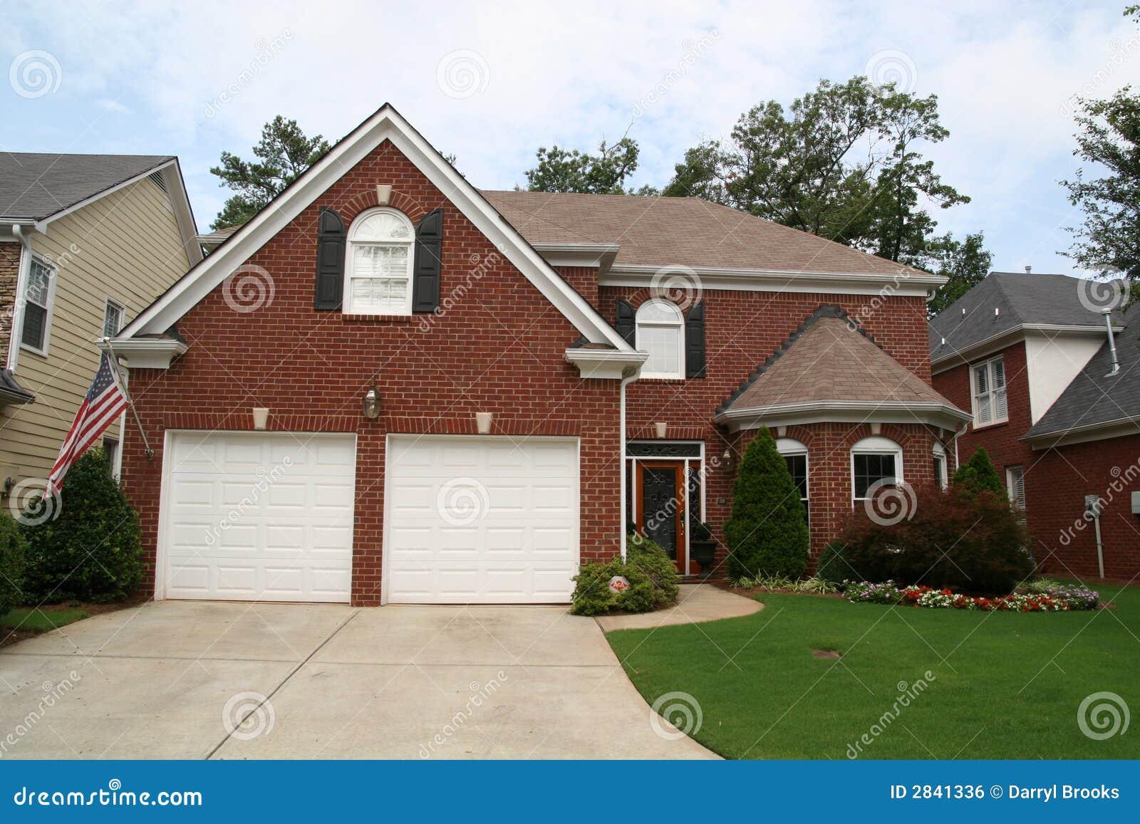 Casa americana del mattone fotografia stock immagine di for Costo del mattone da costruire
