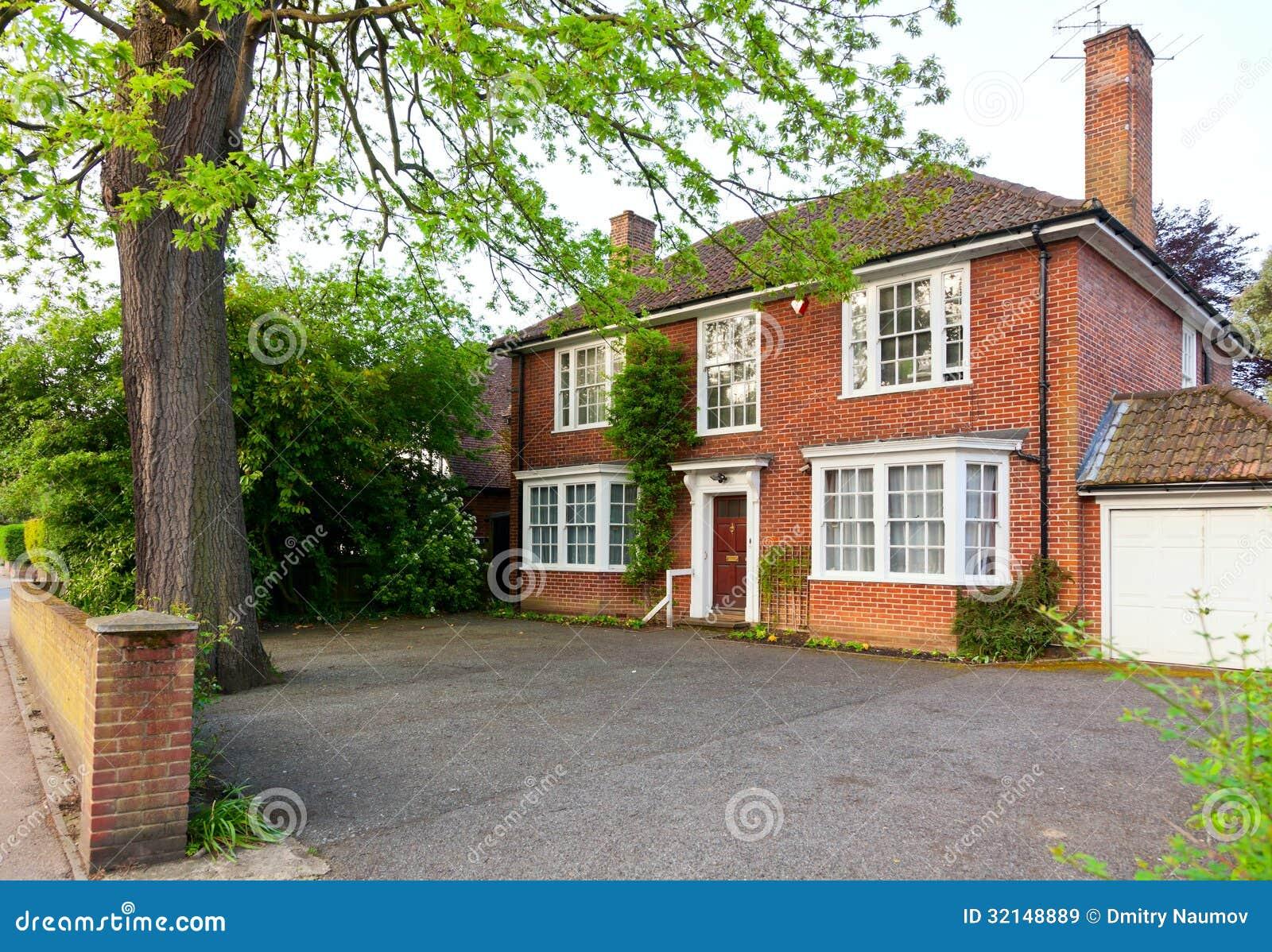 Casa con mattoni a vista inglese immagine stock immagine for Case di mattoni ranch