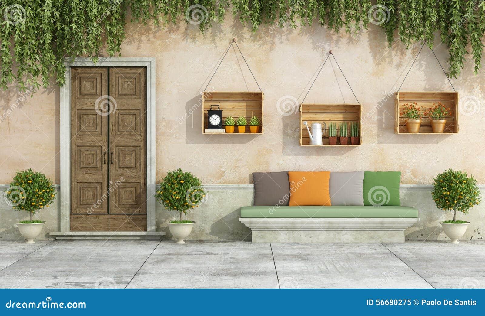 Casa de campo con el banco viejo de la puerta y de la for Las puertas de piedra amazon