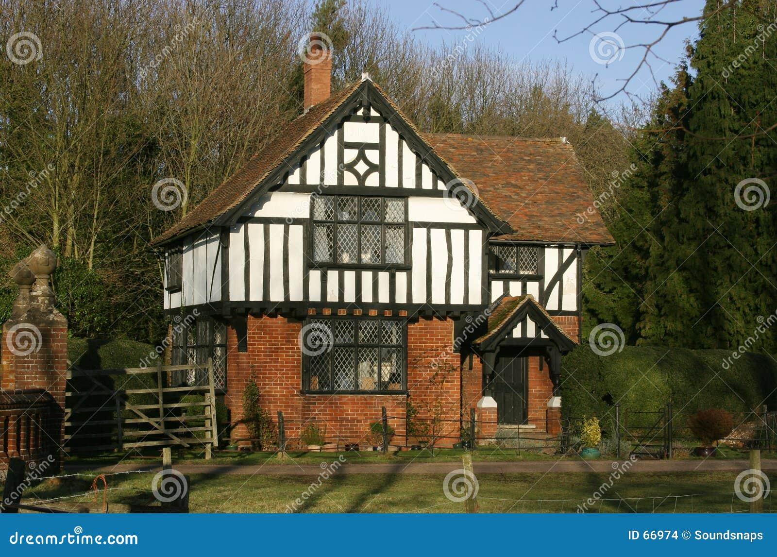 Casa de frame da madeira