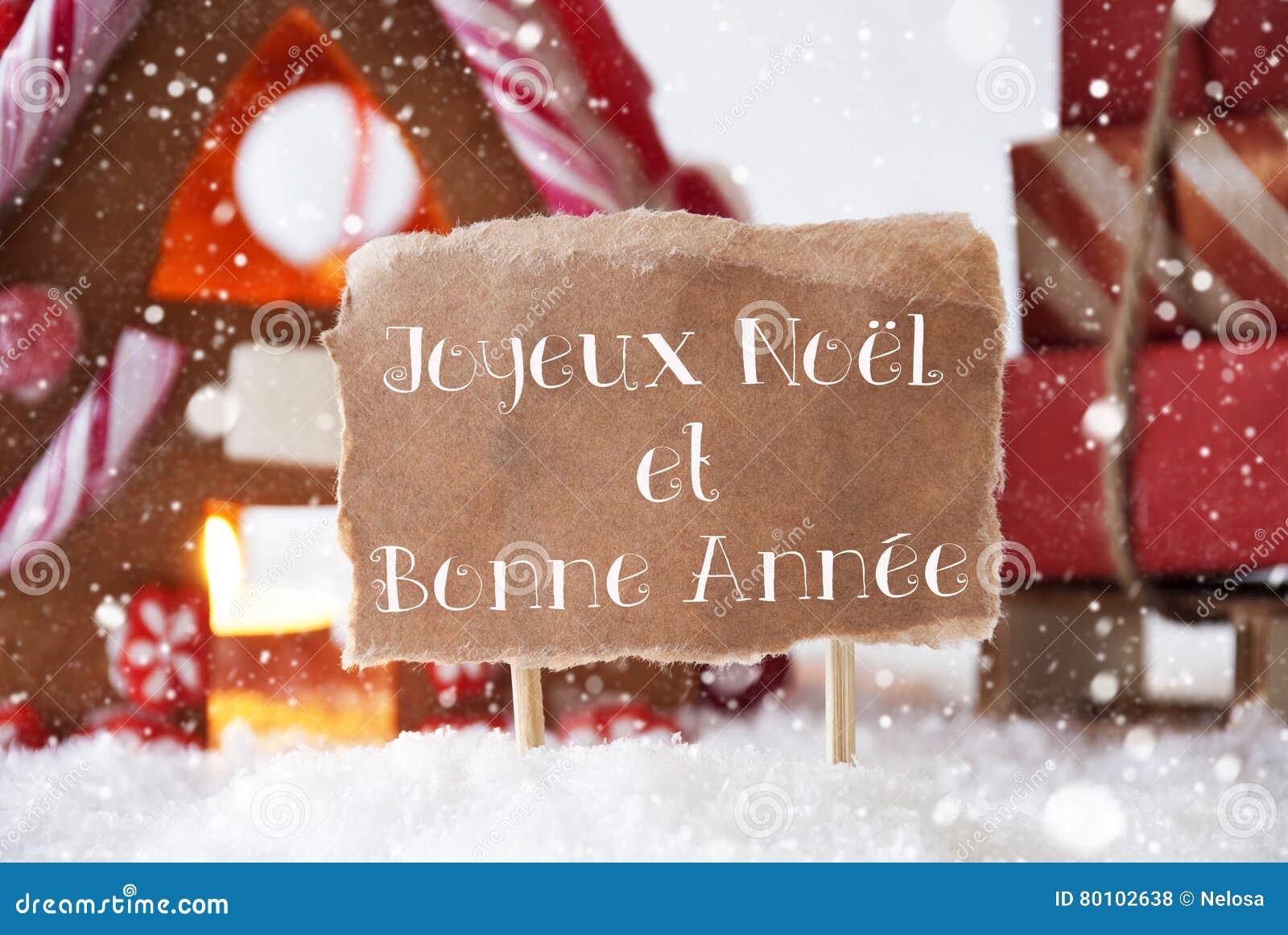 A casa de pão-de-espécie com trenó, flocos de neve, Bonne Annee significa o ano novo