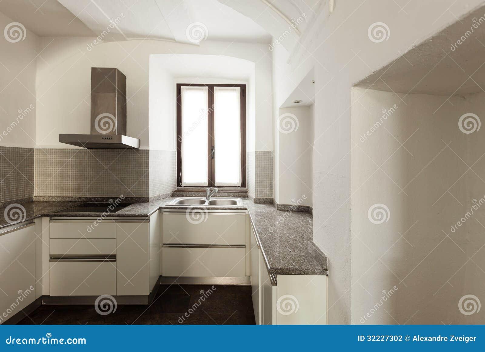 Casa rustica interna cucina fotografia stock immagine for Illuminazione rustica della cabina