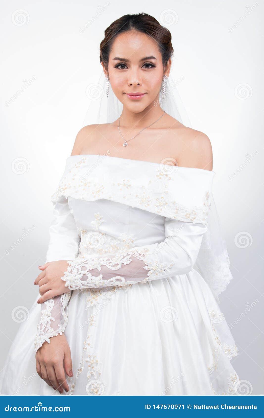 Casamento branco da noiva bonita asi?tica bonita da mulher
