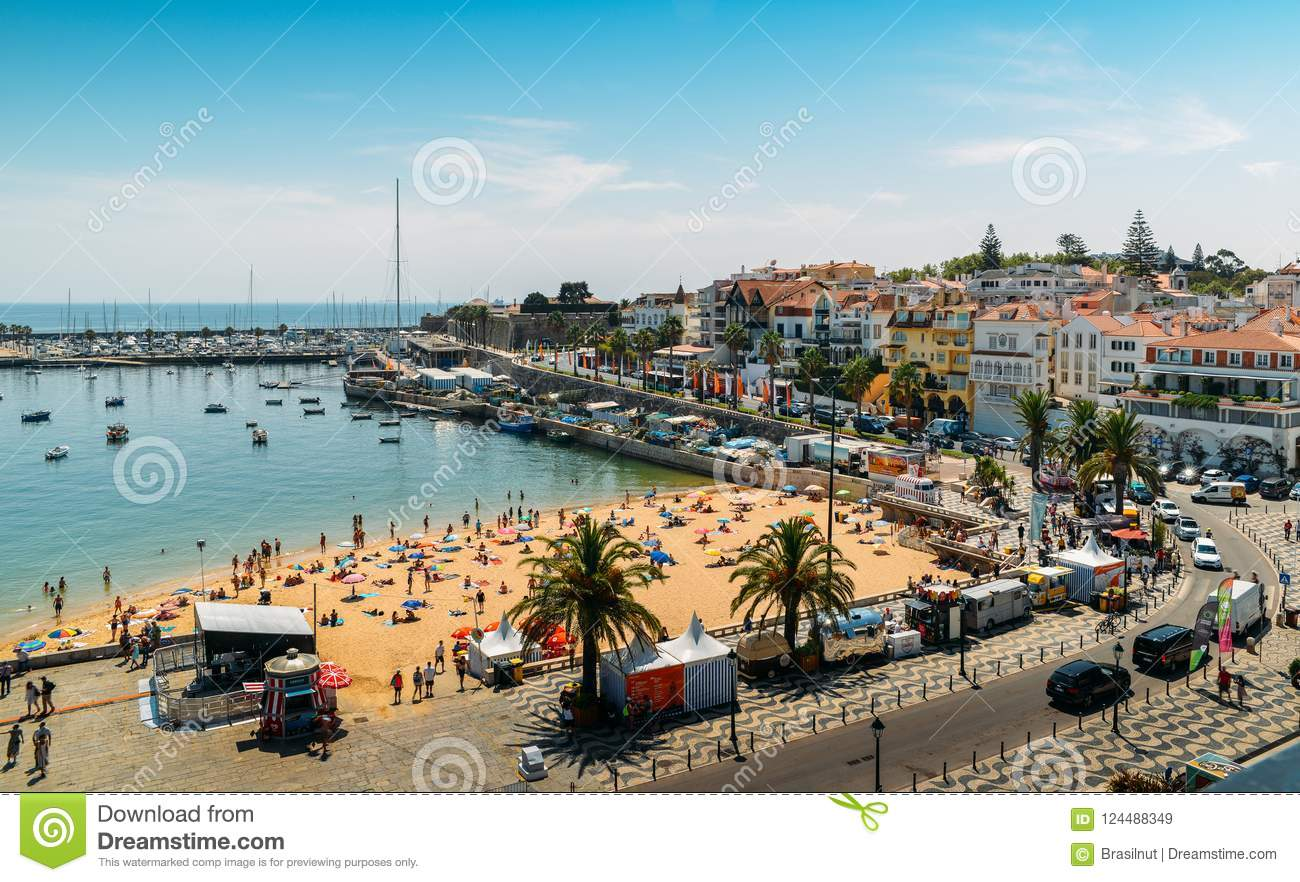 High Vantage Point Of Crowded Sandy Praia Do Ribeiro And Boats On