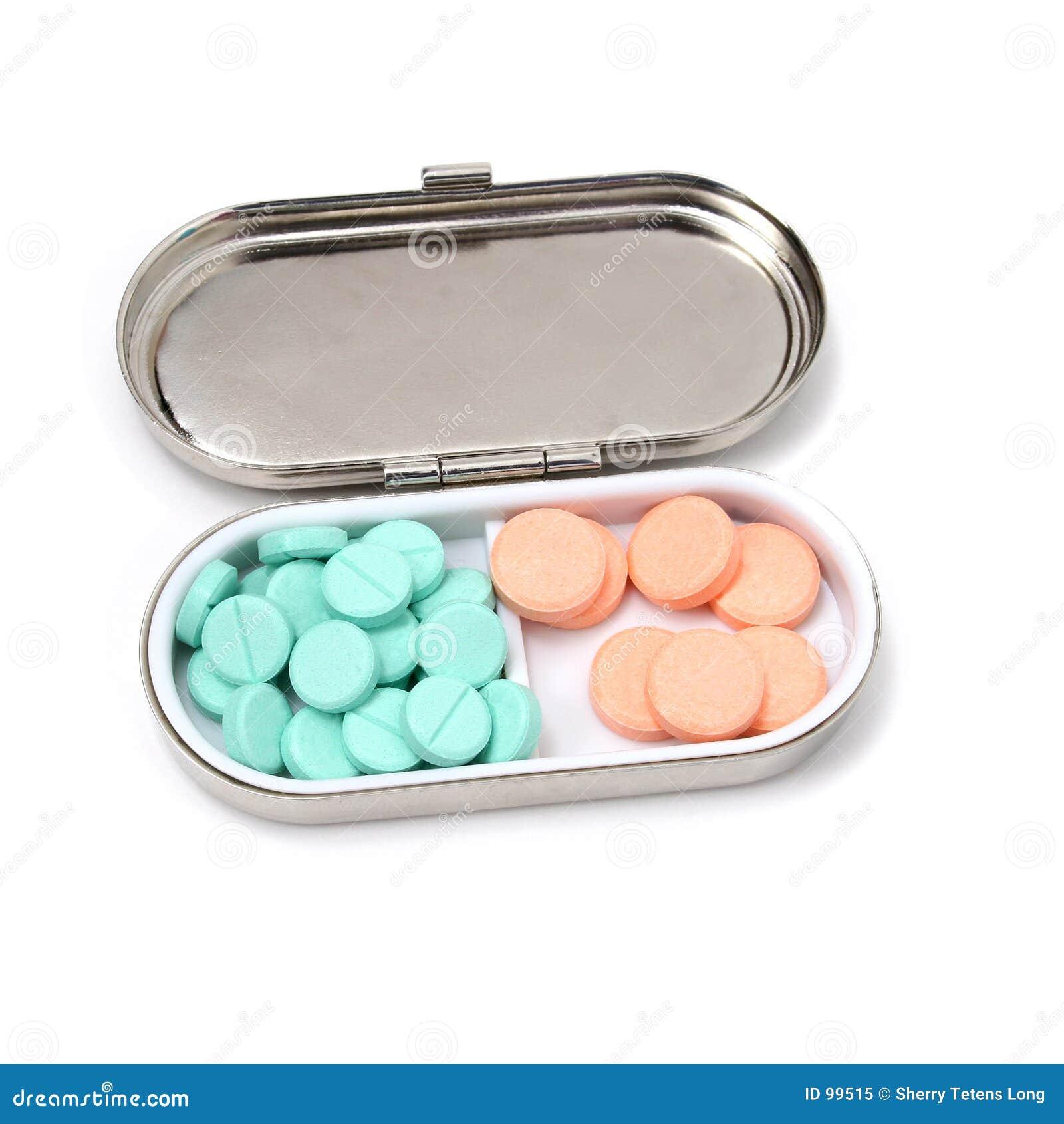 Casella della pillola dell oggetto d antiquariato con i ridurre in pani verdi ed arancioni