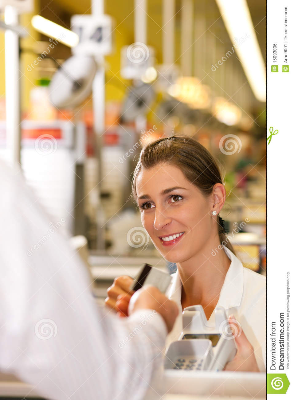 Supermarket Cashier Cashier in supermarket taking