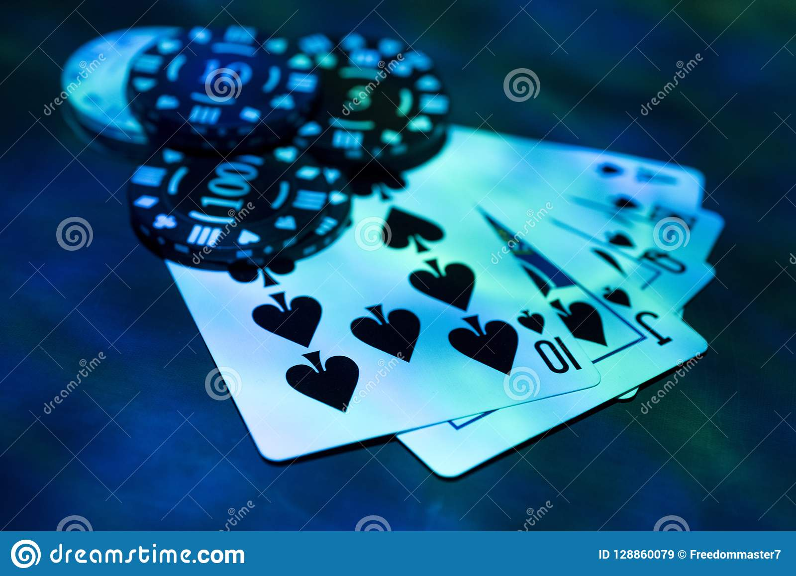 Casino abstract photo. Poker game on red background. Theme of gambling