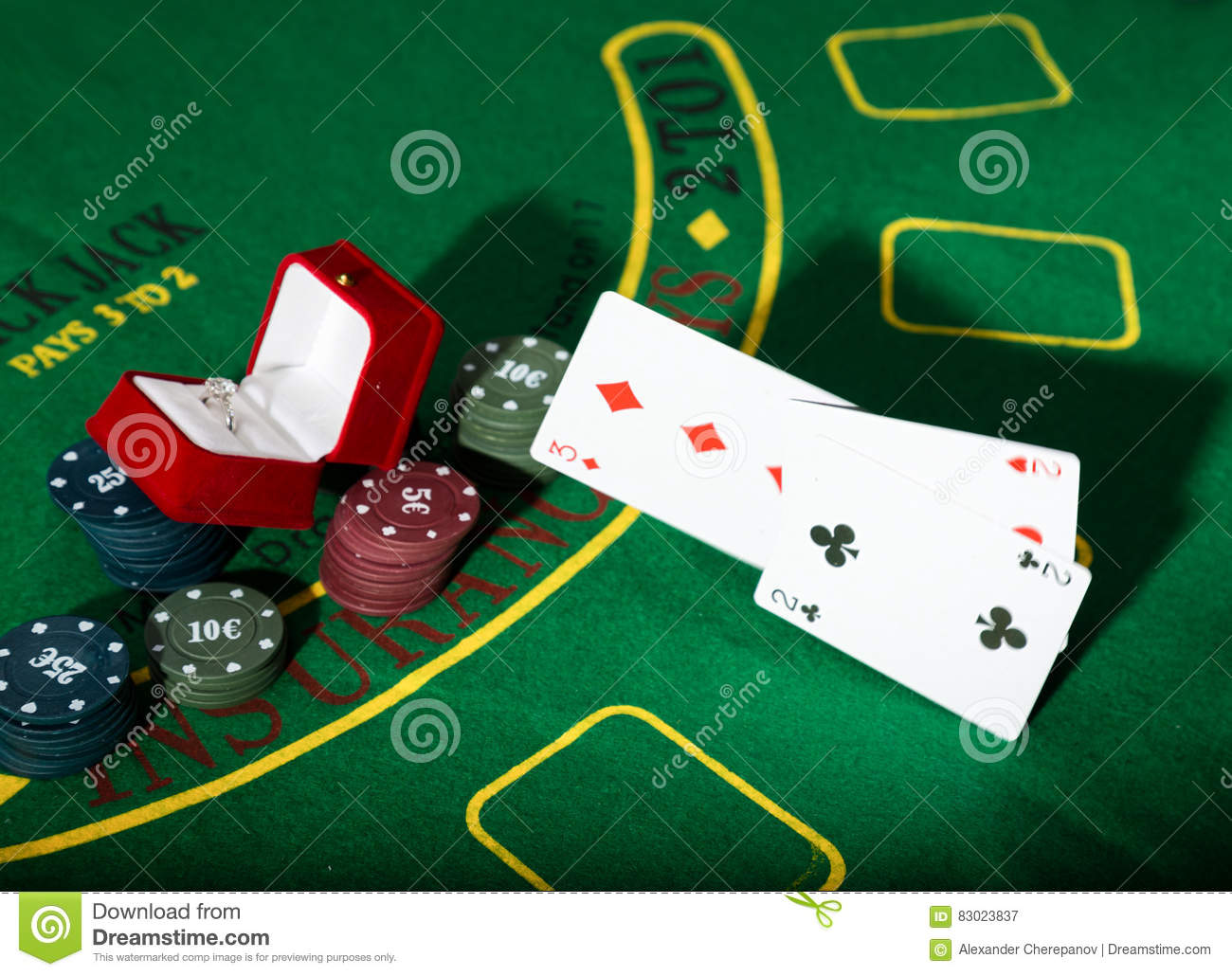 Poker table background - Casino Chips And A Precious Ring On Green Poker Table Background Man Throws Cards With