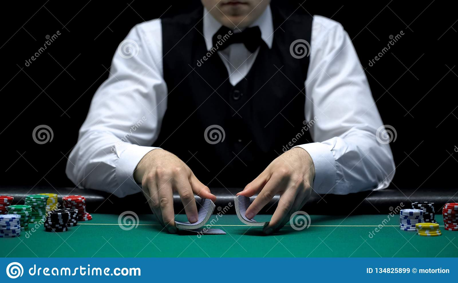 Casino dealer making shuffling tricks with cards, gambling, lucky poker game
