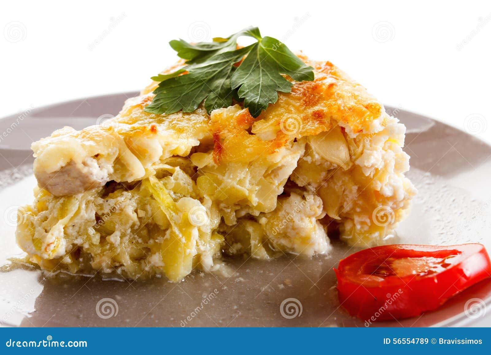 Download Casserole, η κολοκύνθη και το κρέας, τηγάνισαν με το τυρί, τυρί εξοχικών σπιτιών σε ένα γυαλί Στοκ Εικόνα - εικόνα από σκόρδο, κανένας: 56554789