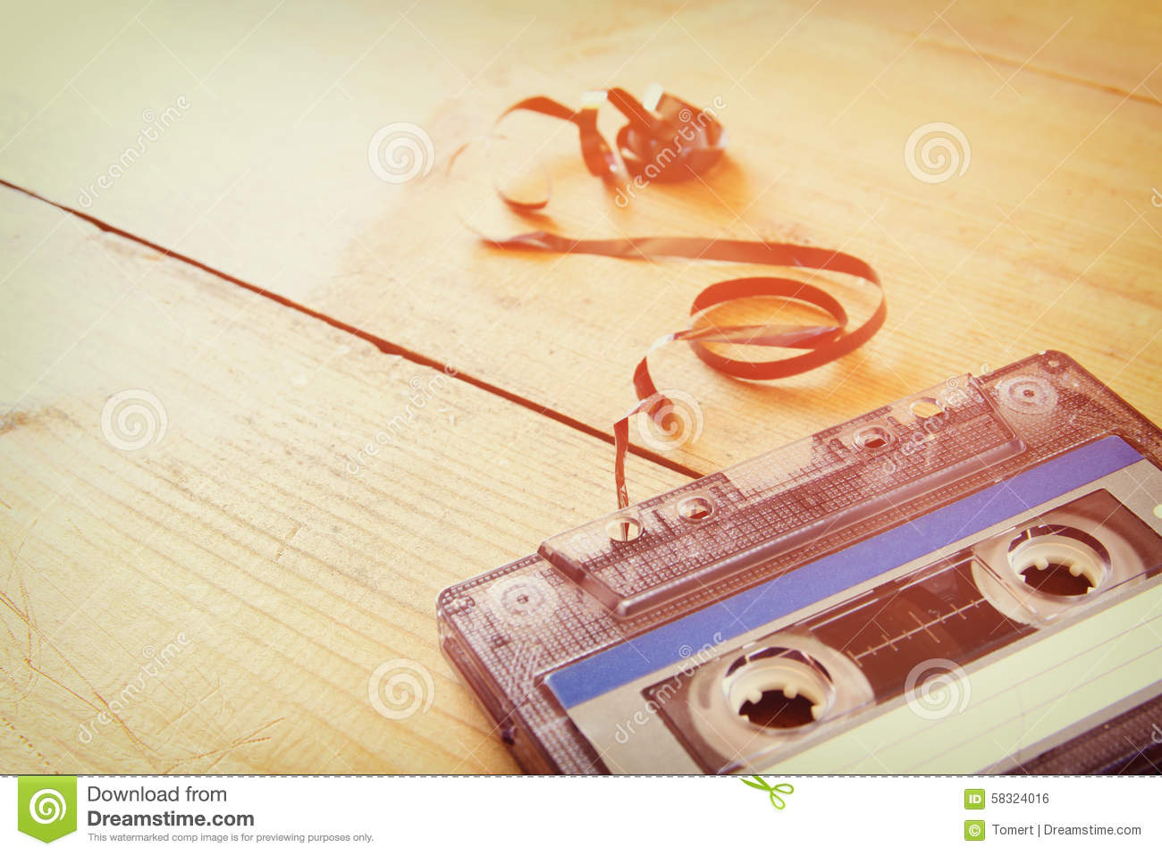 Cassette Tape Over Wooden Table With Tangled Ribbon Top View Retro Filter
