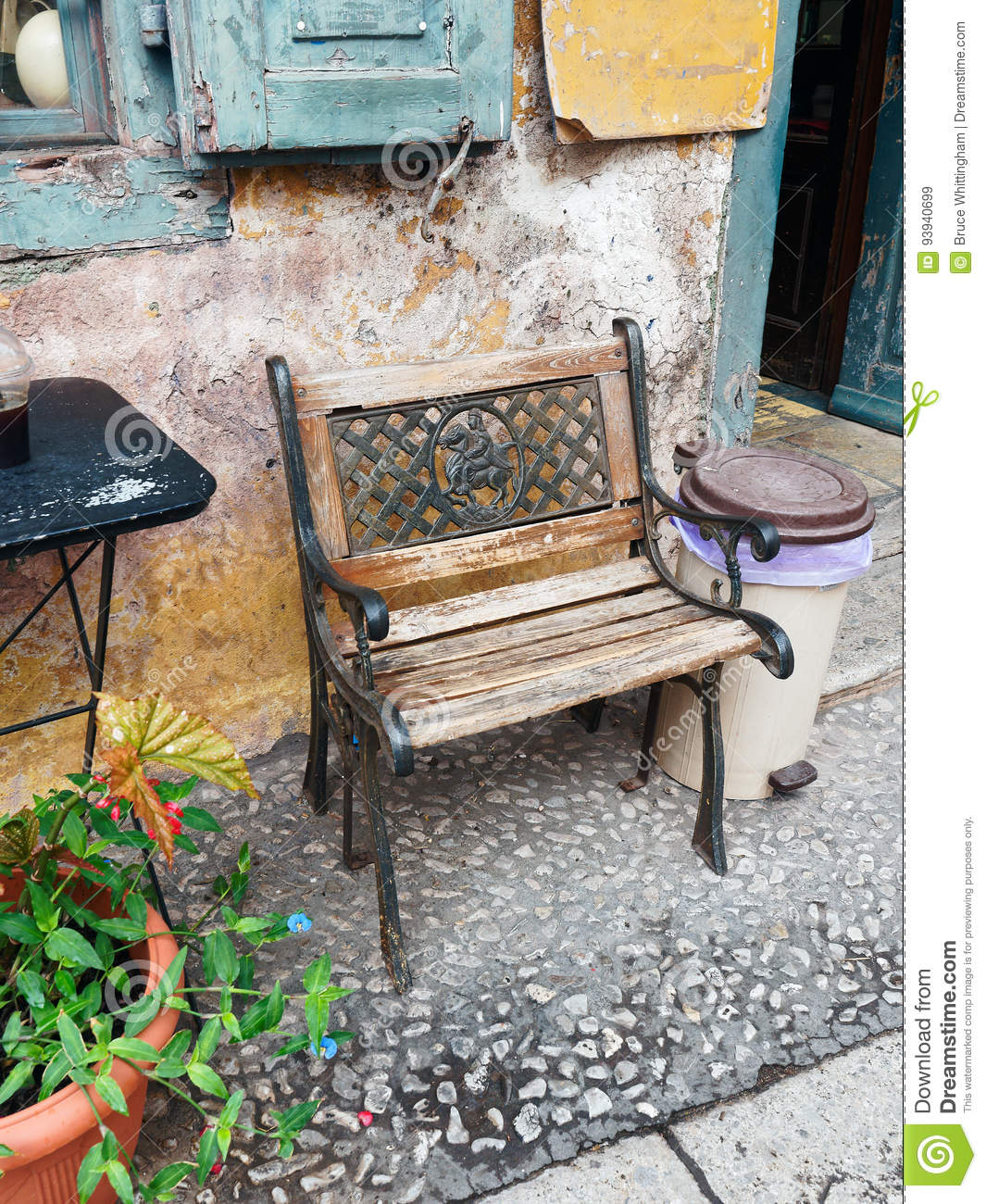 Magnificent Cast Iron And Wood Bench Outside Old Cafe Stock Image Pabps2019 Chair Design Images Pabps2019Com