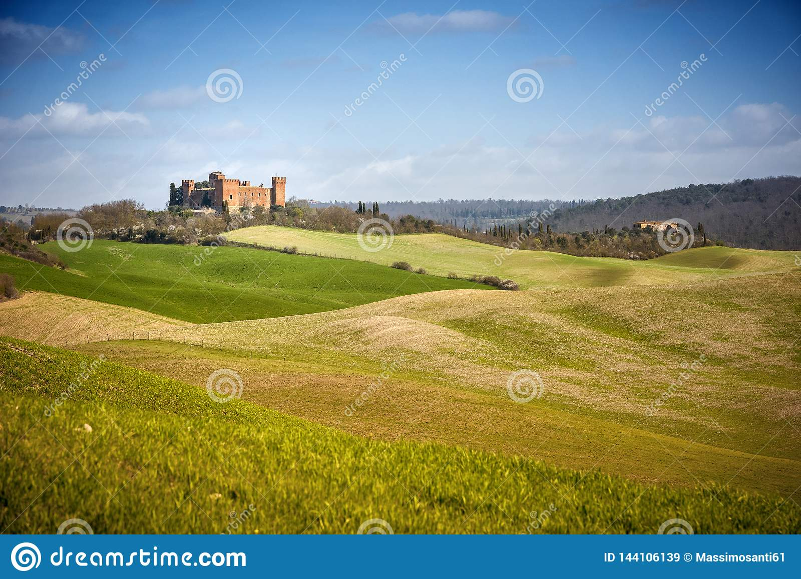 View of Castle of Gallico. Beautiful landscape of hills and fields near Asciano in Tuscany, Siena, Italy
