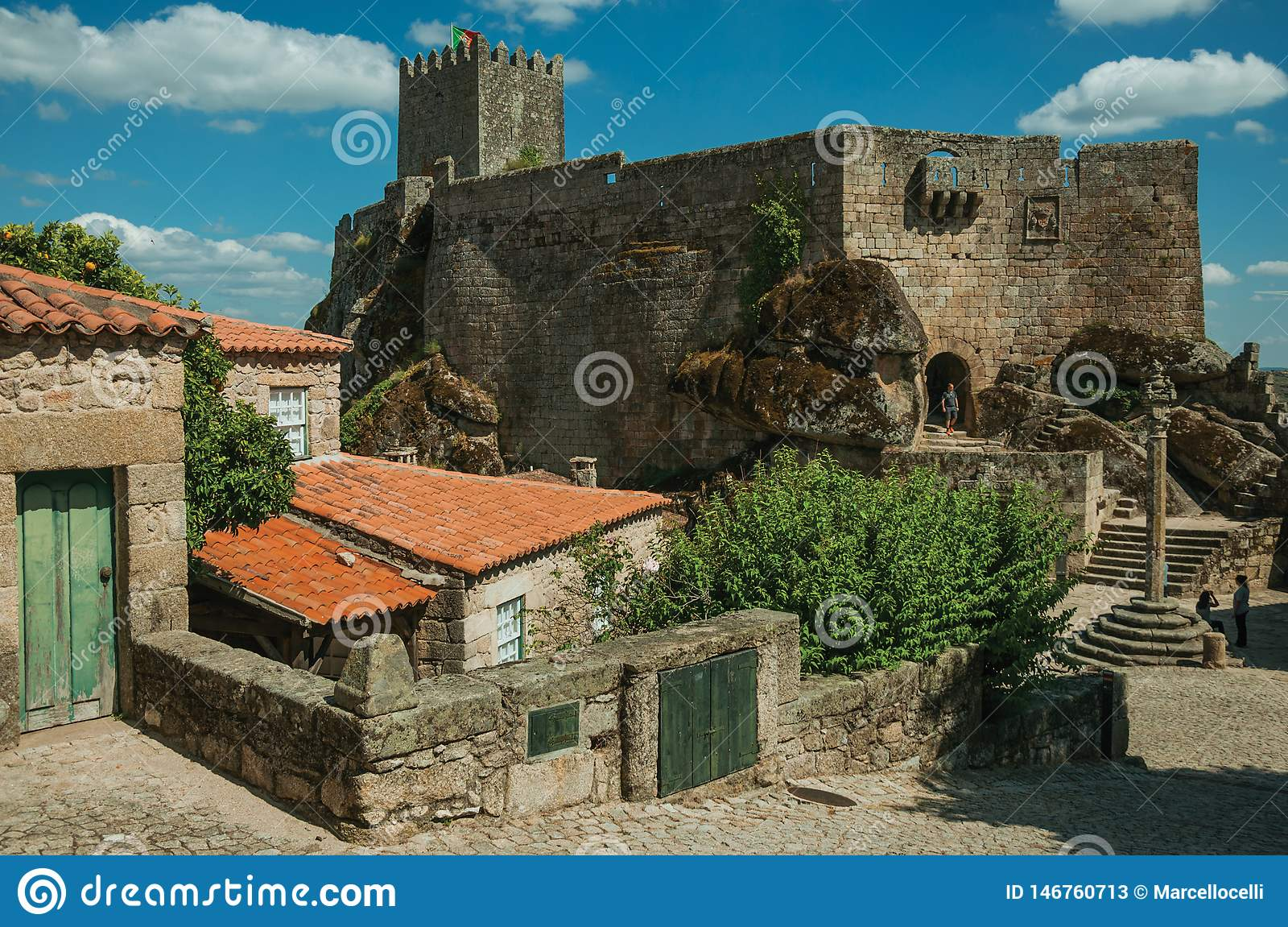 Castle and old houses encircling square with pillory