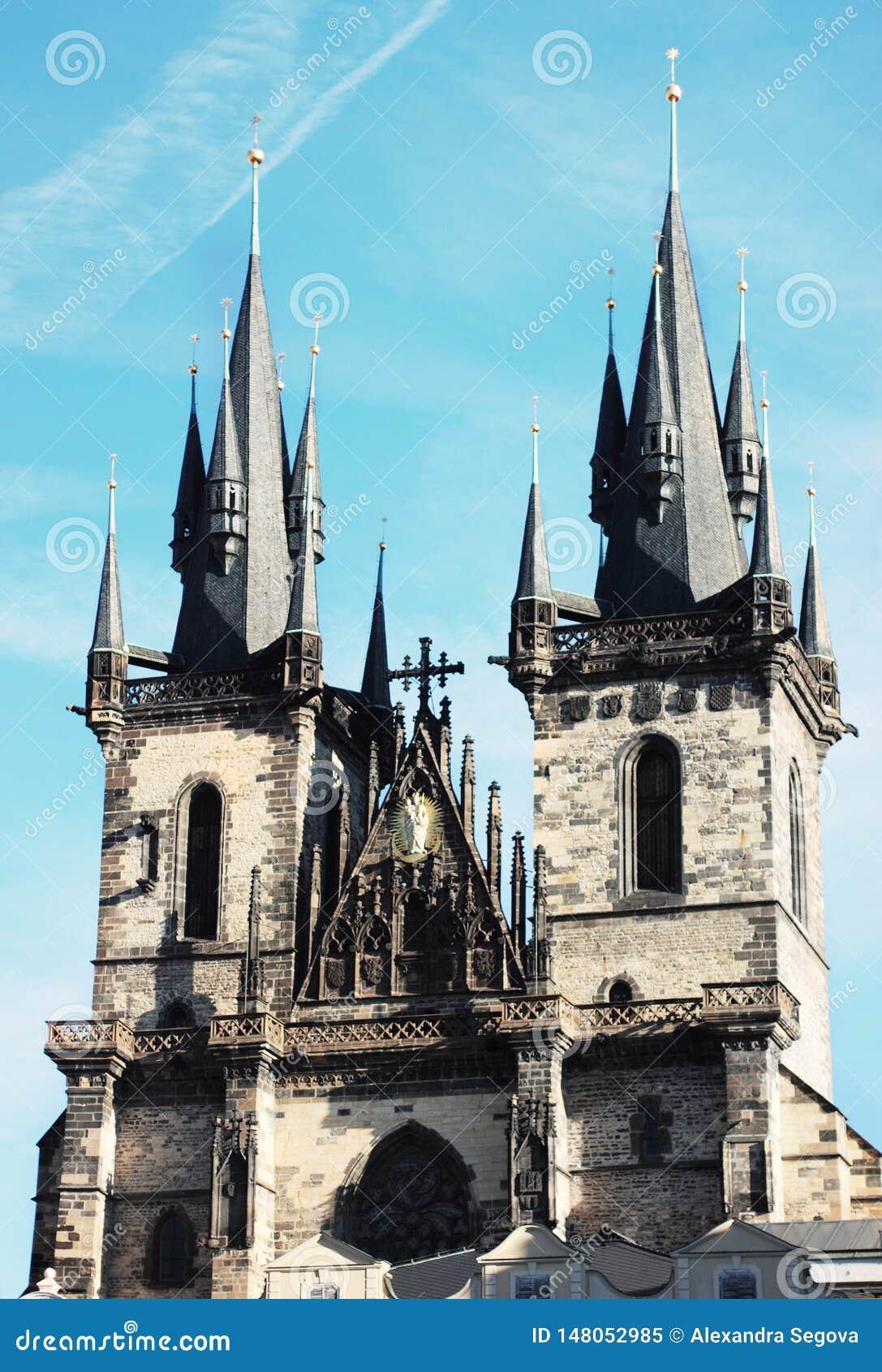 Two castle towers in bright blue sky in Prague, Czech Republic. Popular sightseen. Staromest