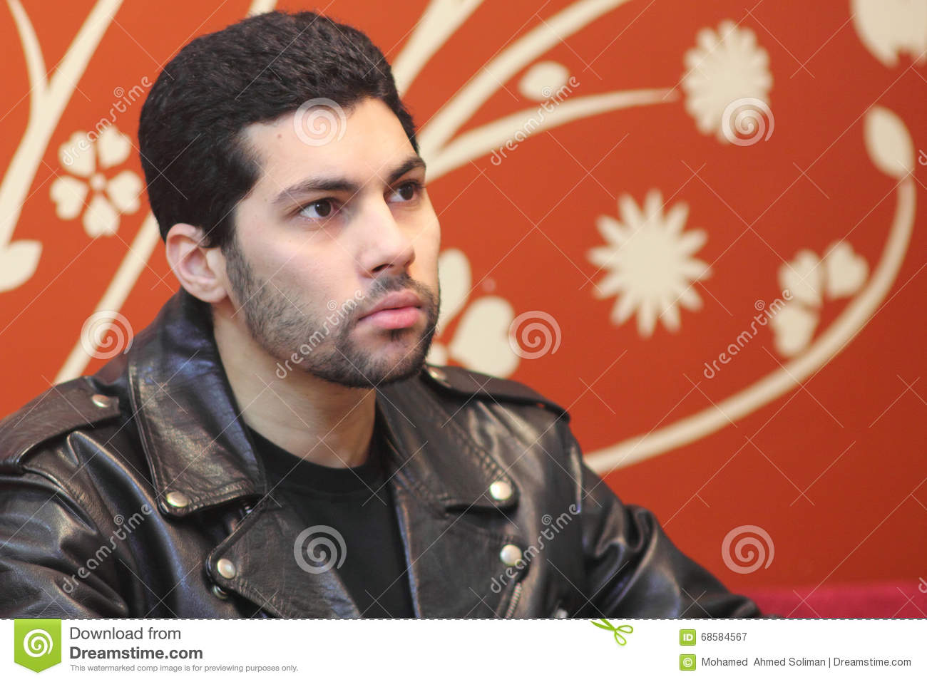 Casual arab young egyptian businessman thinking
