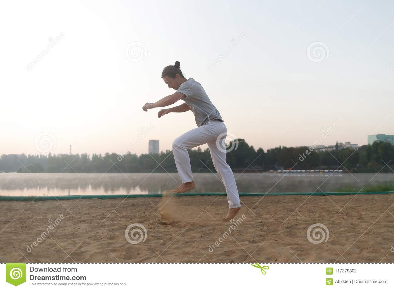 dc10e70ad53 Casual Athletic Man Get Ready To Jump On The Beach While Workout ...