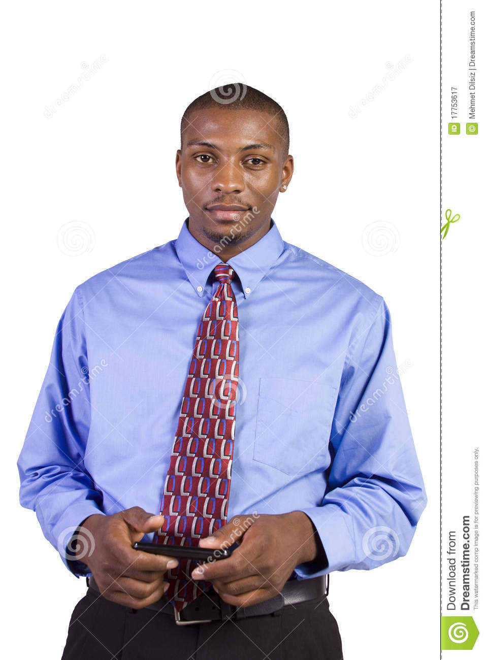 Man On Cell Phone : Casual black man texting on his cell phone royalty free