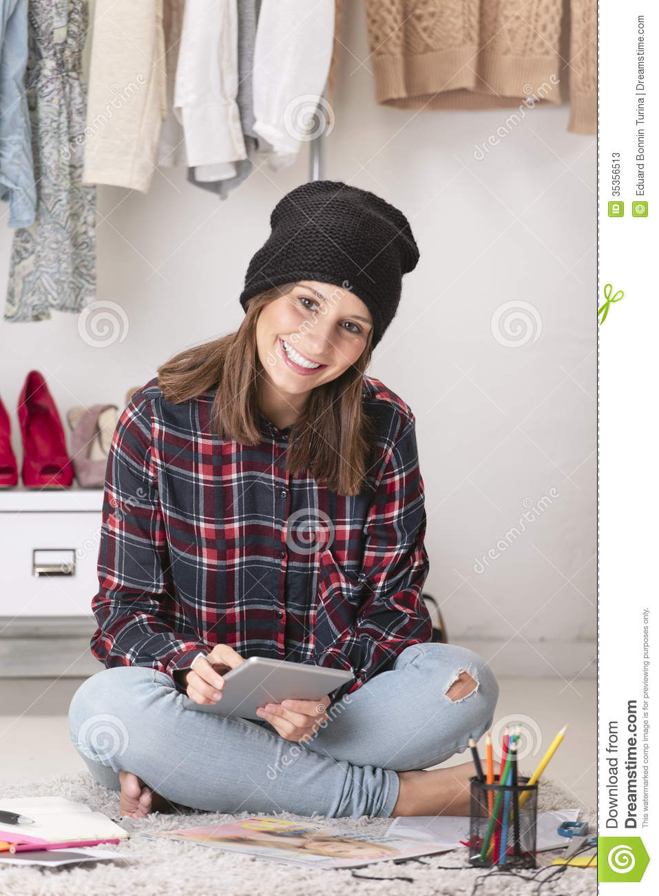 Casual blogger woman working with digital tablet in her fashion office.
