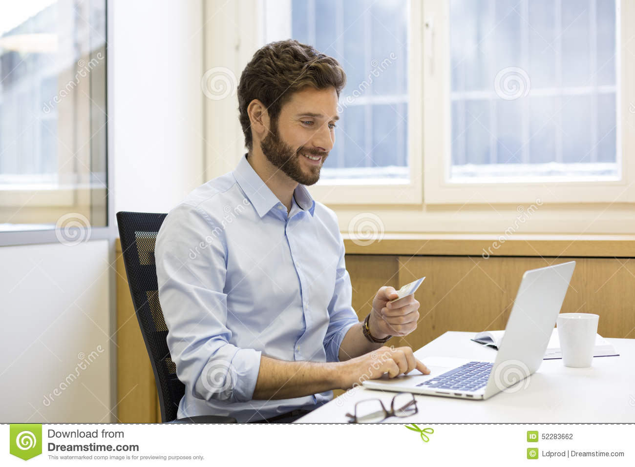 casual business man paying online with credit card