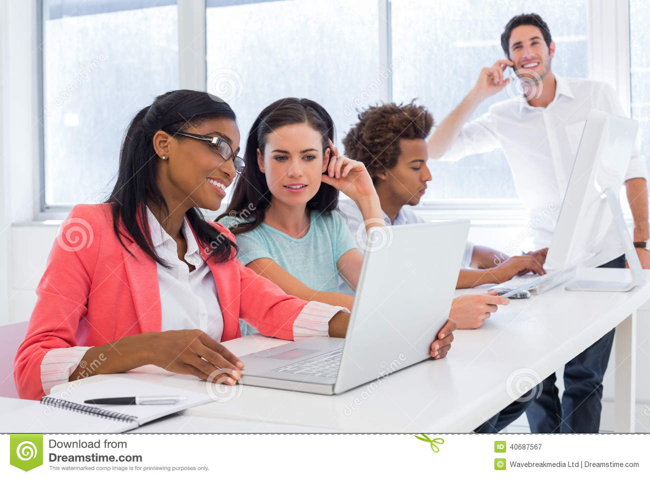 Casual Business People Shaking Hands At Desk Stock Photo ...  |Relaxed Business Person