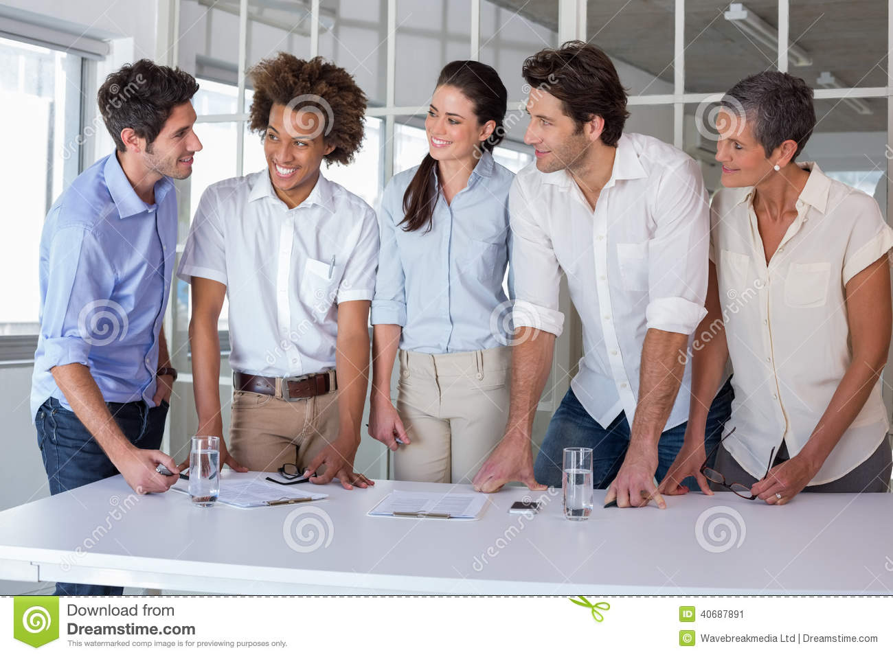 Casual Business Team Having A Meeting Standing Stock Photo Image