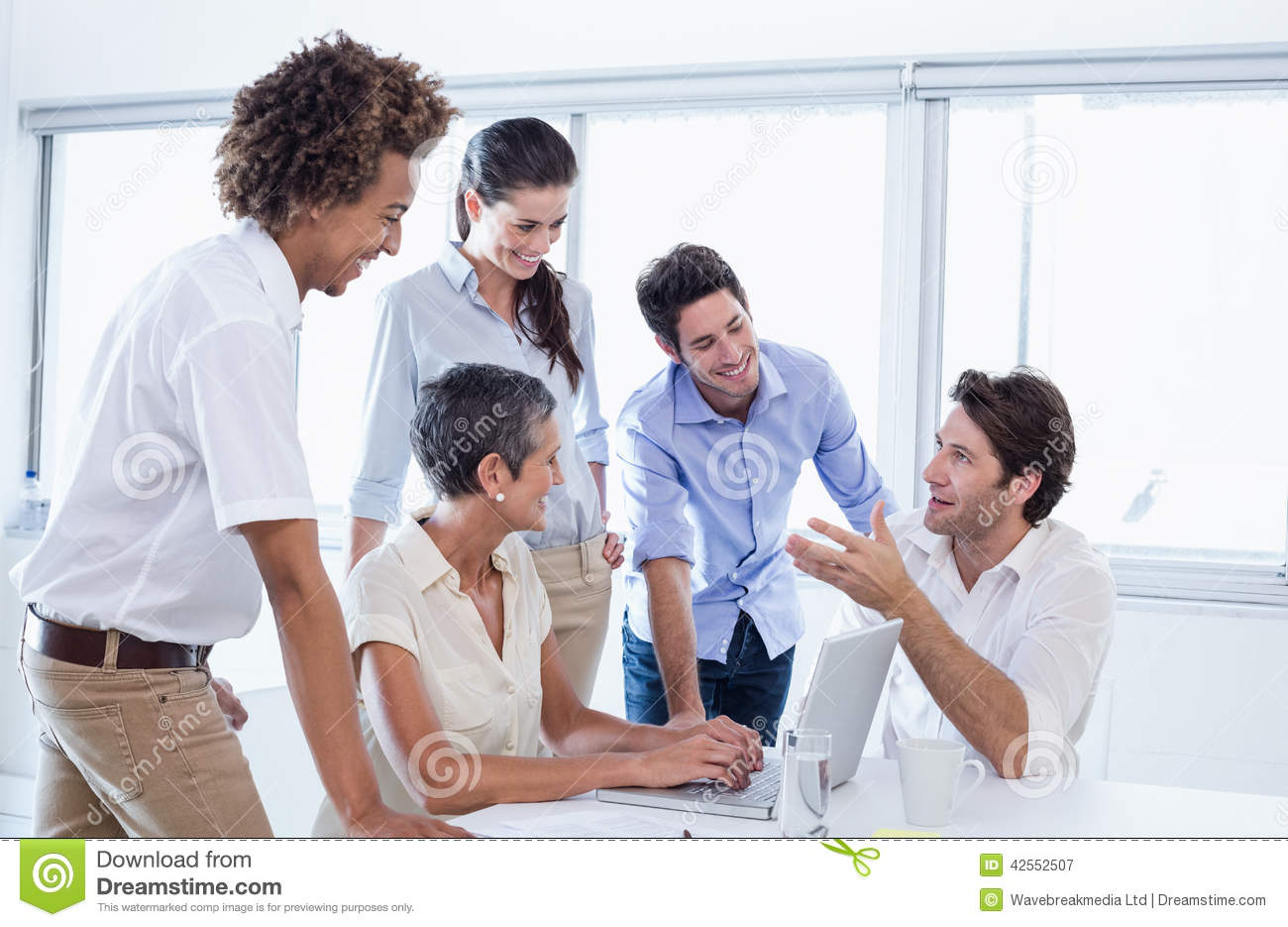 Casual Business Team Having A Meeting Using Laptop Stock Photo Image