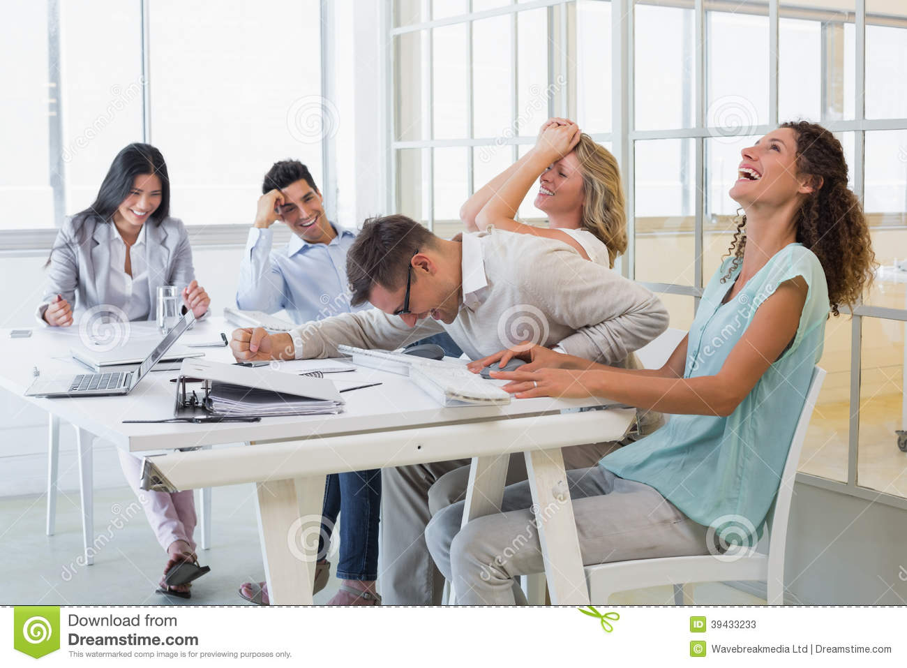 Casual Business Team Laughing During Meeting Stock Photo Image