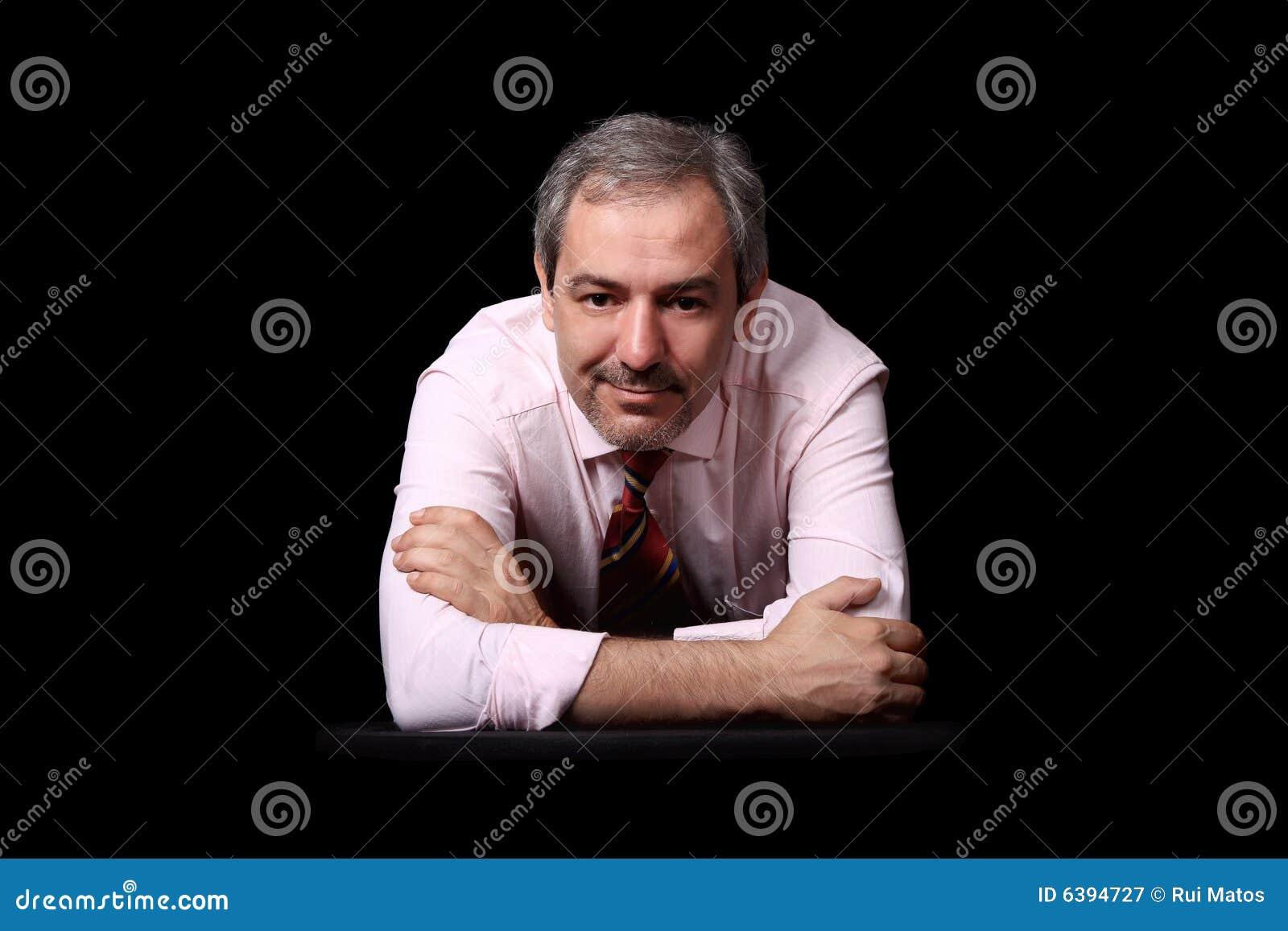 Casual businessman portrait over black