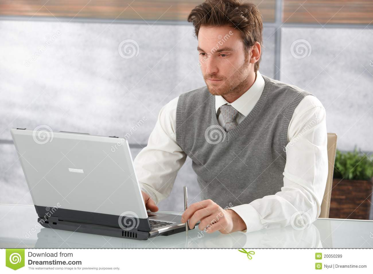 Casual businessman working on laptop