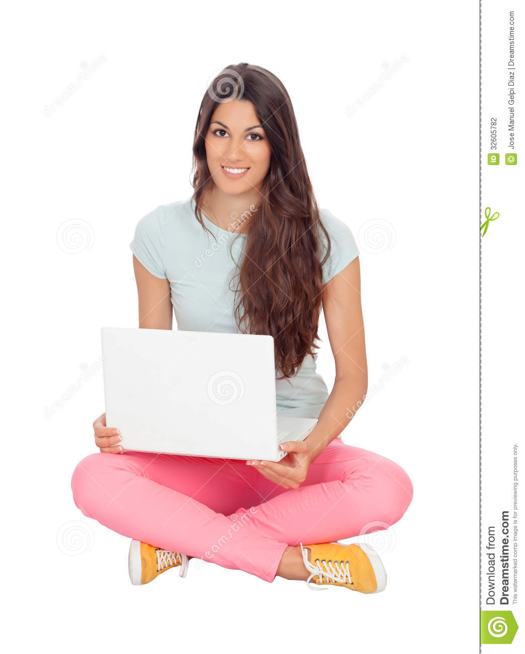 Casual girl sitting on the floor with a laptop stock for On the floor on the floor