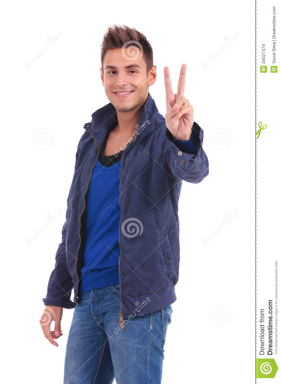 Casual man in a blue jacket is making the victory hand sign