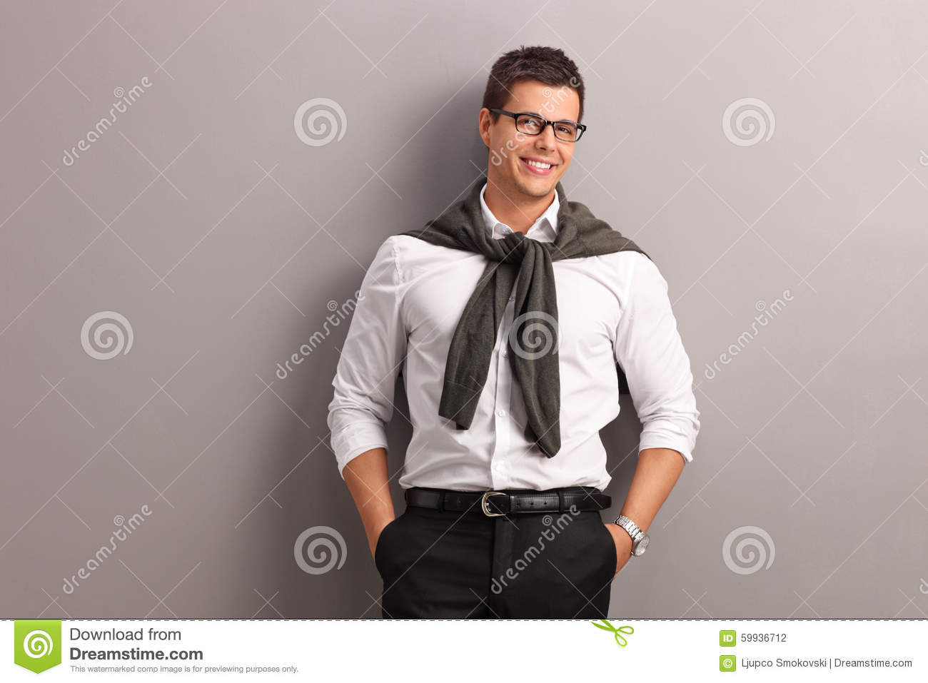Casual Man With His Sweater Tied On His Shoulders Stock Photo