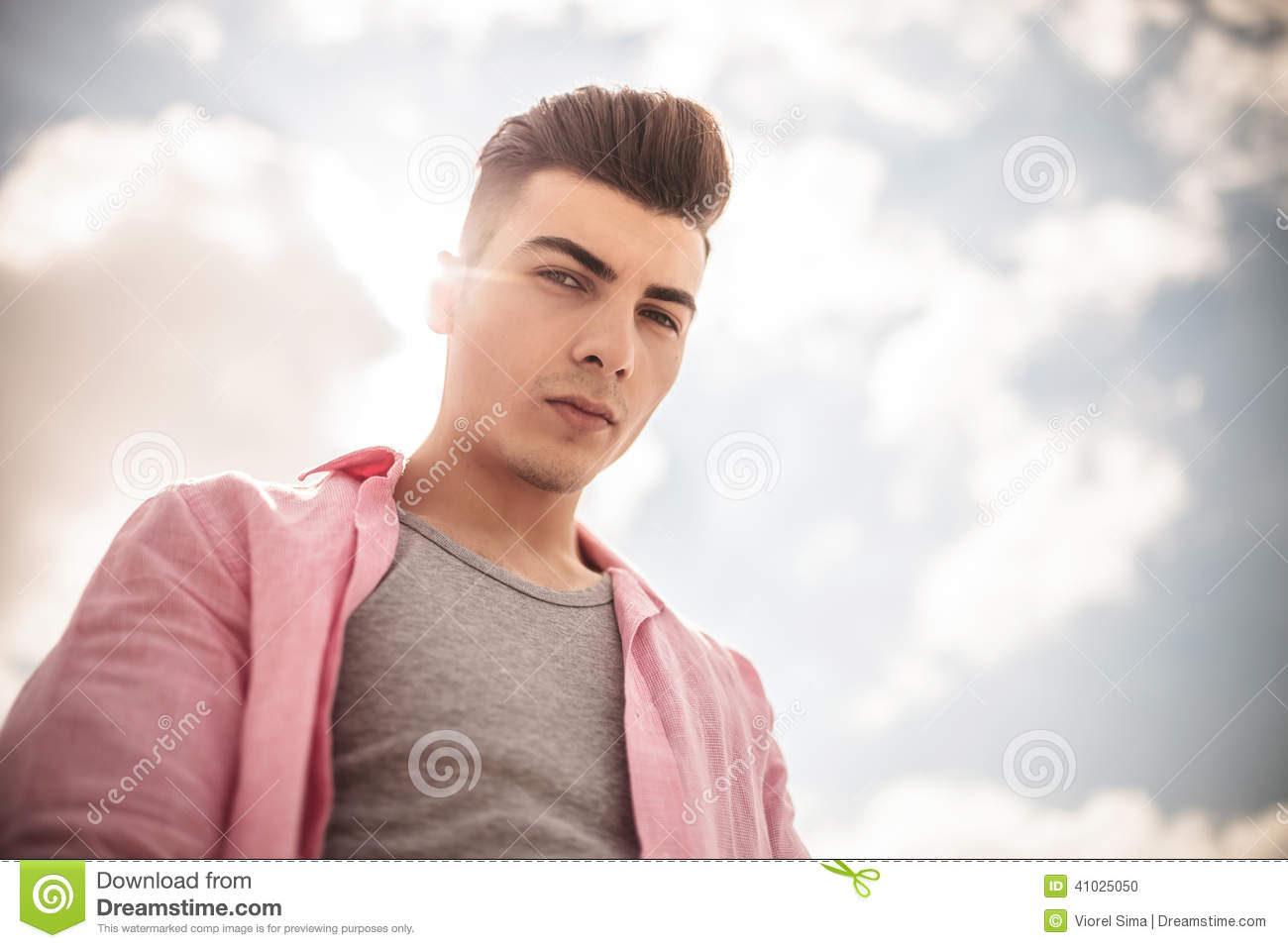 Casual Man Looking Down To The Camera Stock Photo Image