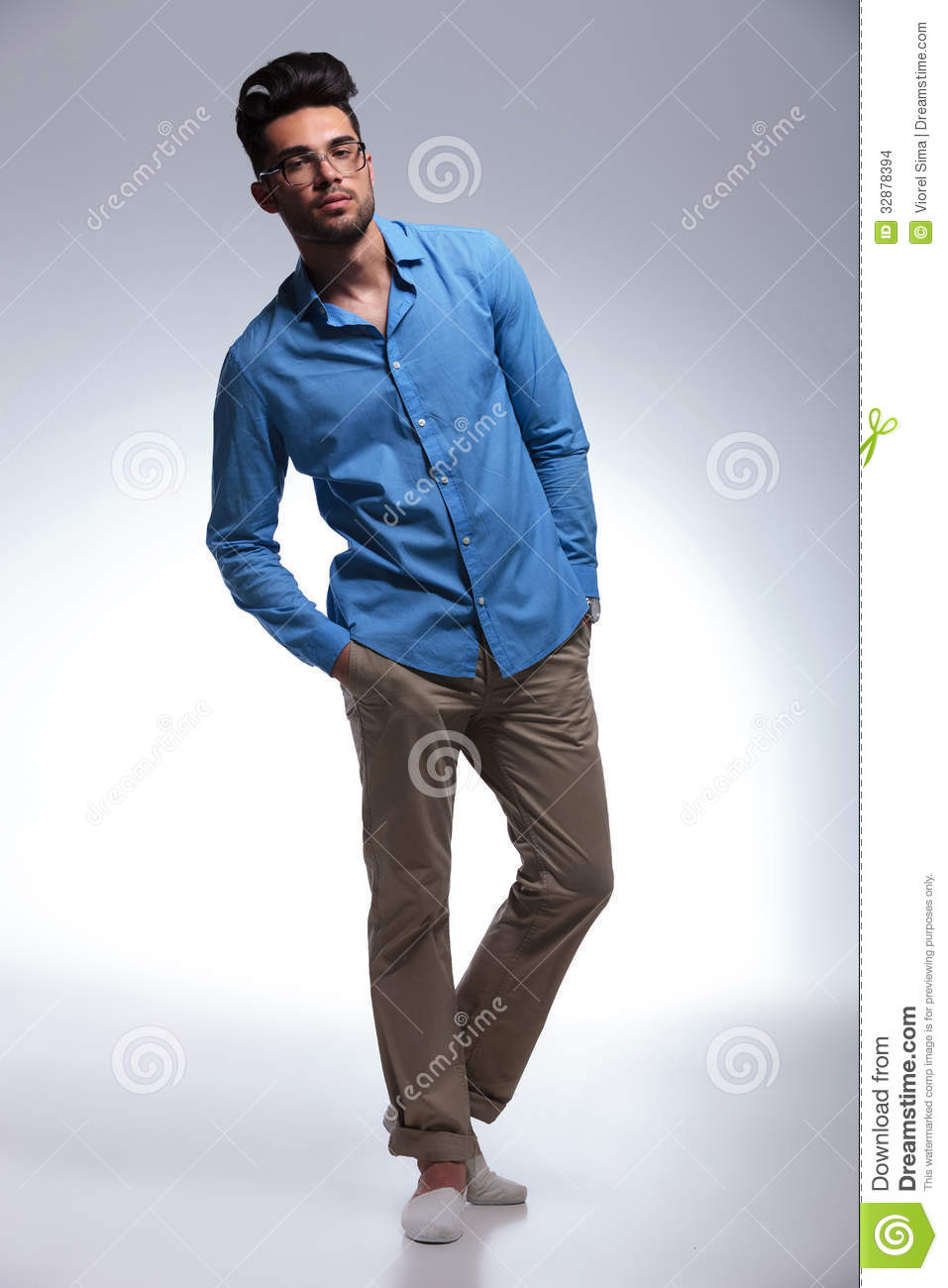 Casual Man Poses With Hands In Pockets Stock Photo - Image