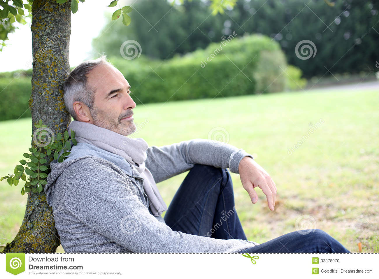Casual Man Sitting In Garden Stock Photo - Image of peaceful, hair