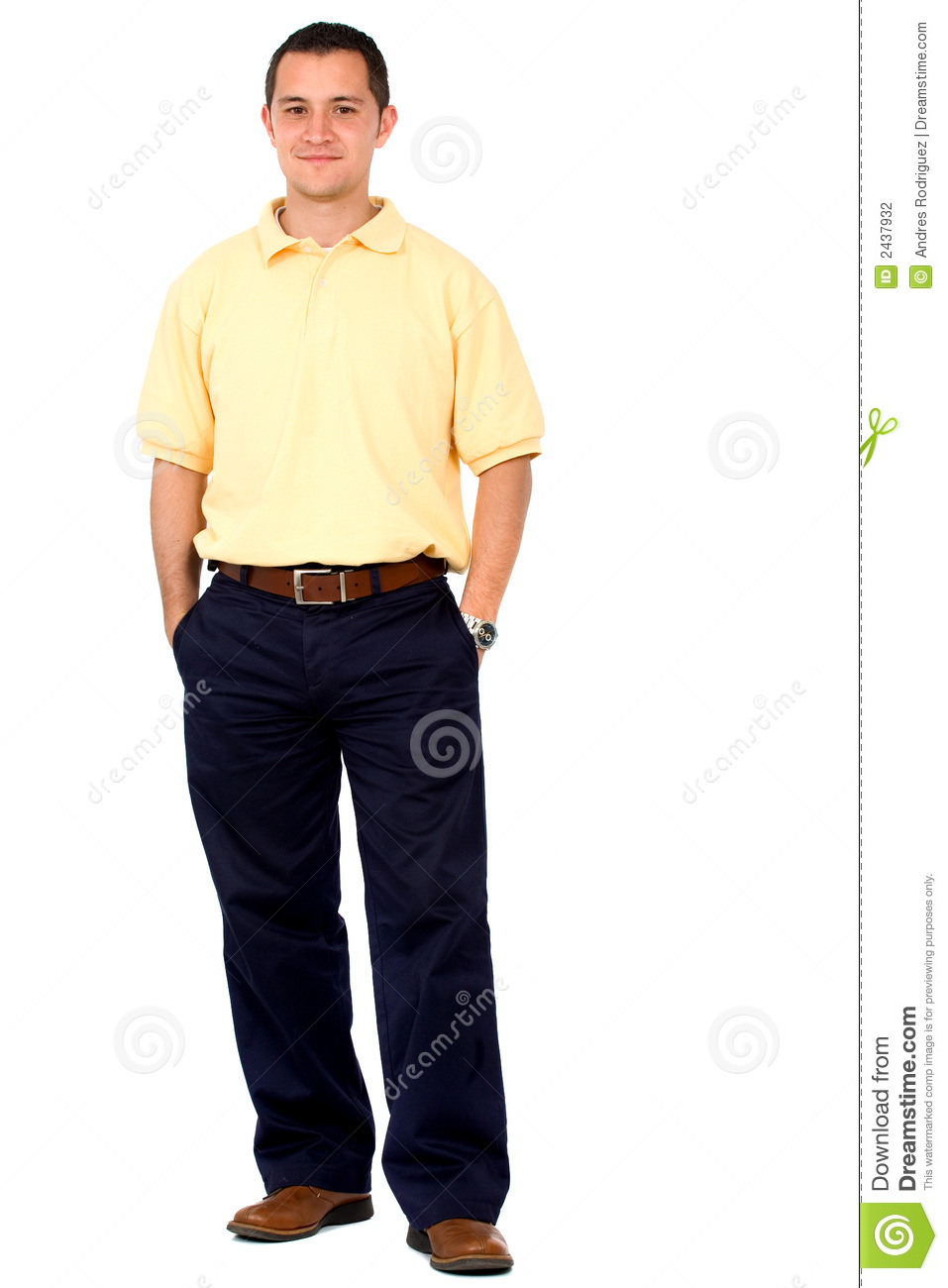 Casual friendly man in yellow and blue standing isolated over a ...