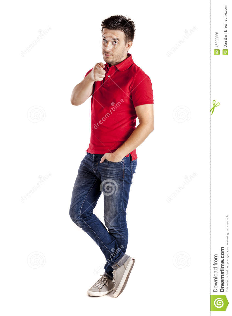 Casual Man With T-shirt And Jeans Pointing At The Camera ...