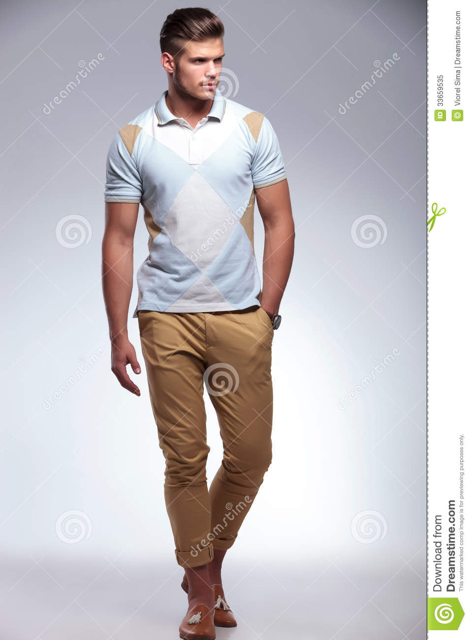 Casual Man Walks With Hand In Pocket Royalty Free Stock