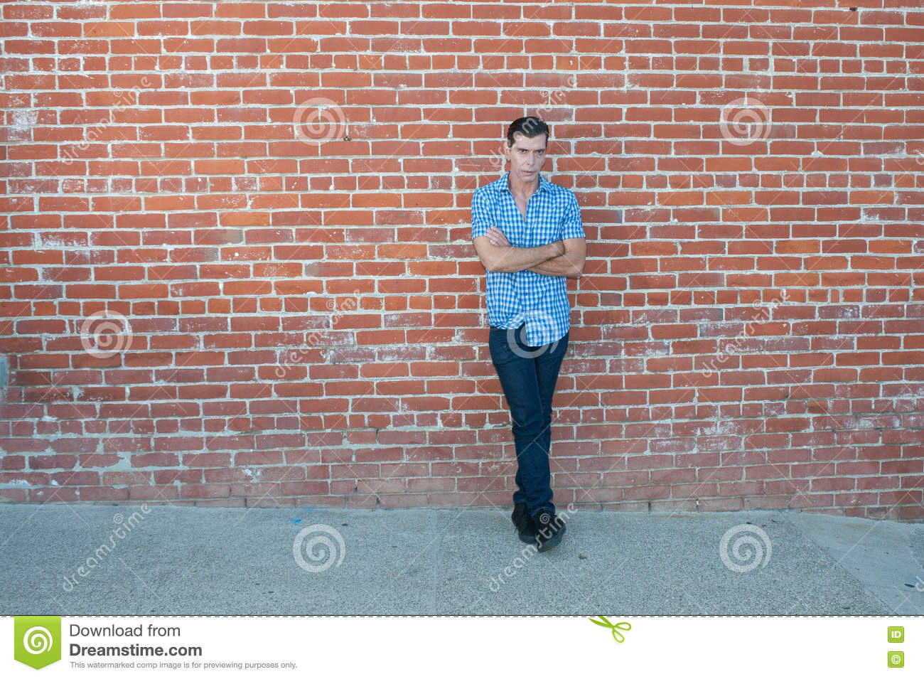 Casual Pose Against Old Building  Stock Image - Image of