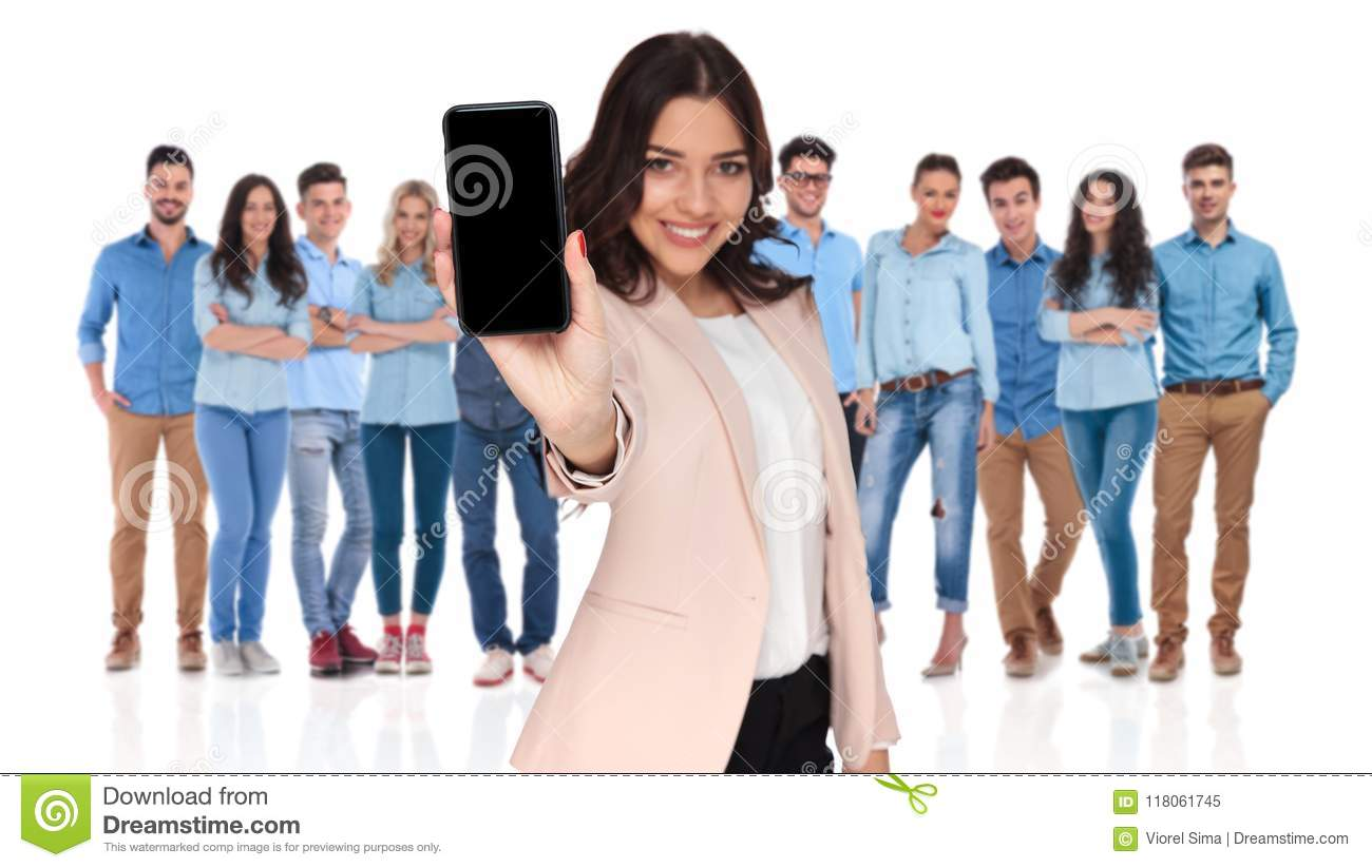 Casual team with businesswoman leader showing telephone screen i