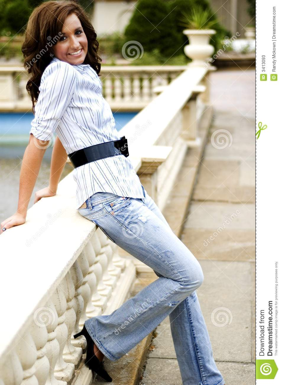 Casual Teen Girl Sitting Criss Cross On The Floor Stock Photography 26509622