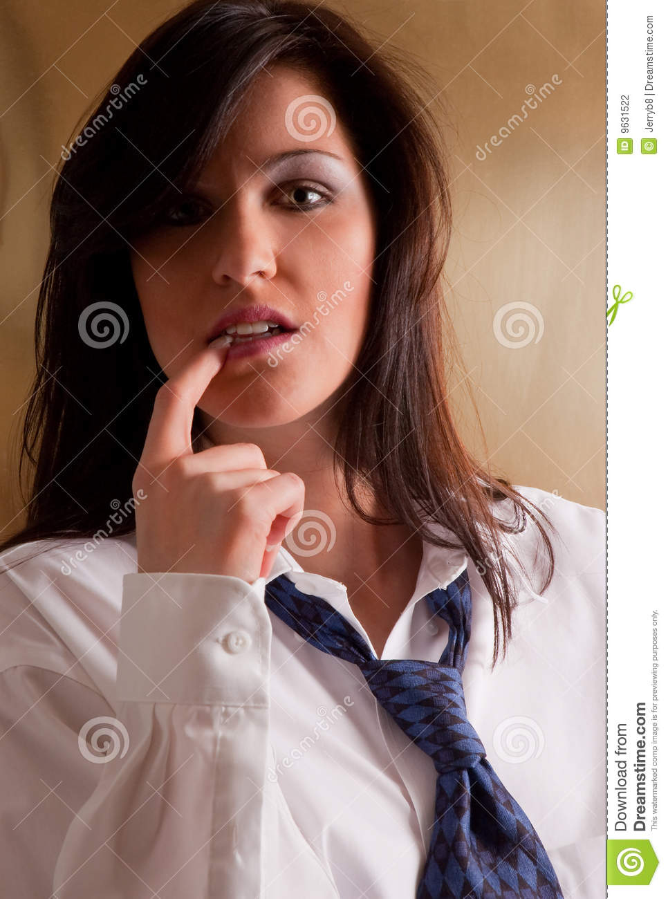 ... of a pretty, young woman casually wearing a man's white shirt and tie