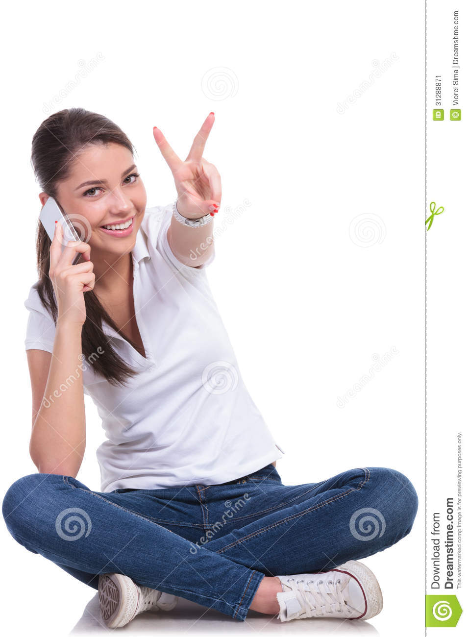Casual woman sits & victory on phone