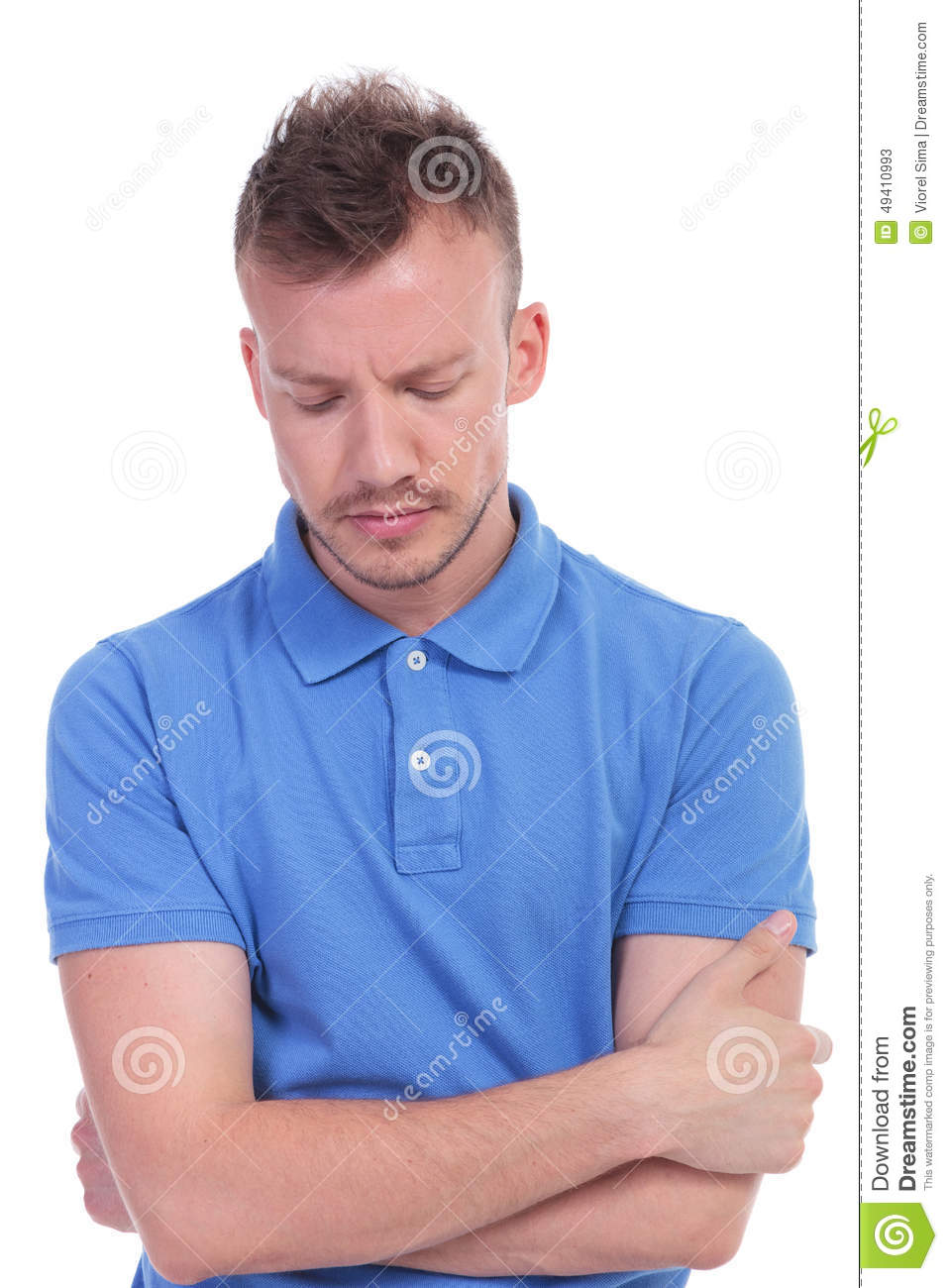 Sad casual man in polo shirt is looking down stock photo for Man in polo shirt