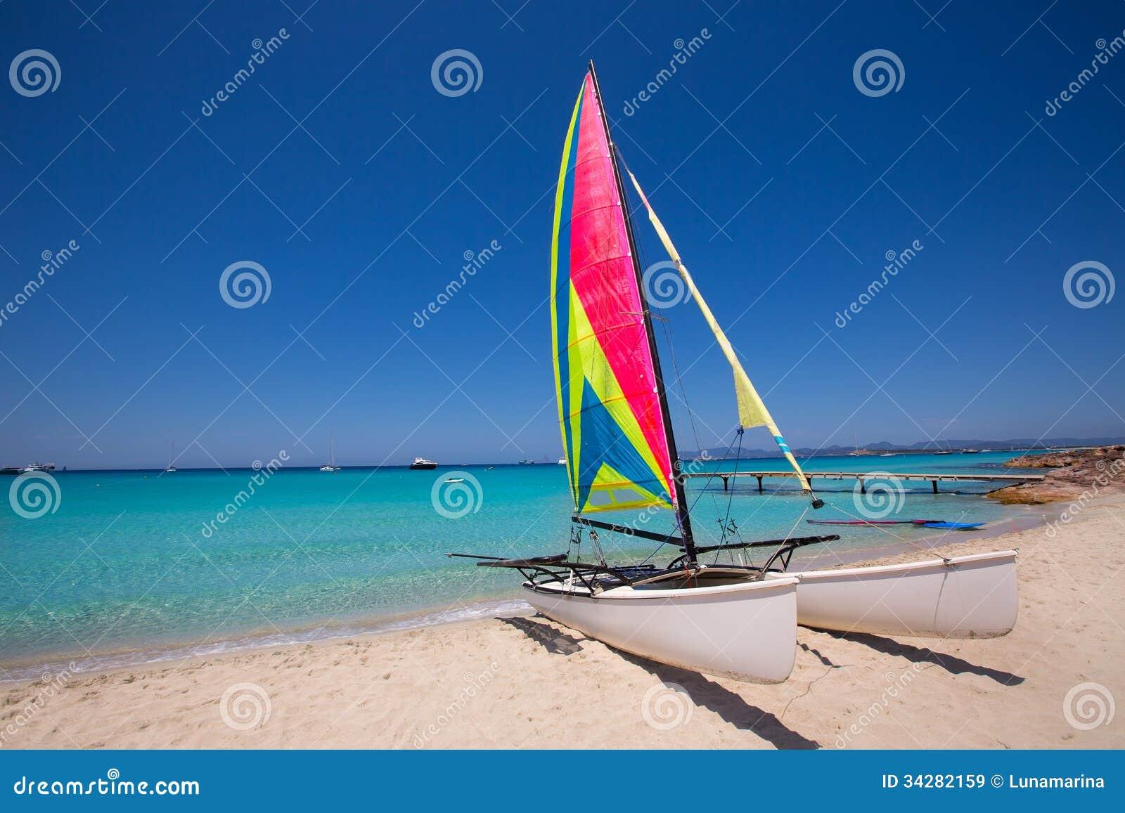 Catamaran Sailboat In Illetes Beach Of Formentera Royalty Free Stock ...