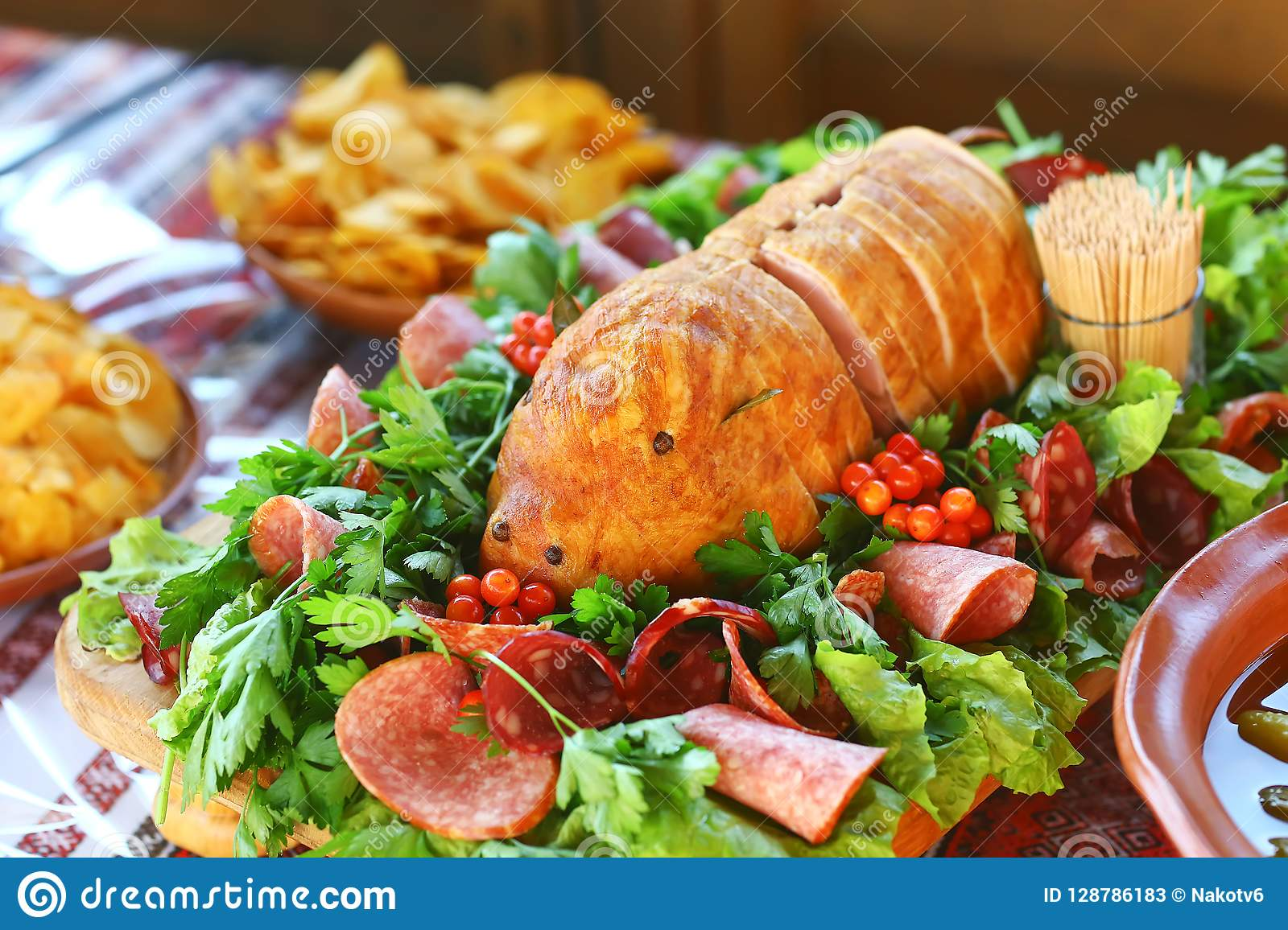 Catering Buffet Food Dish with Meat and Colorful vegetables on a Table