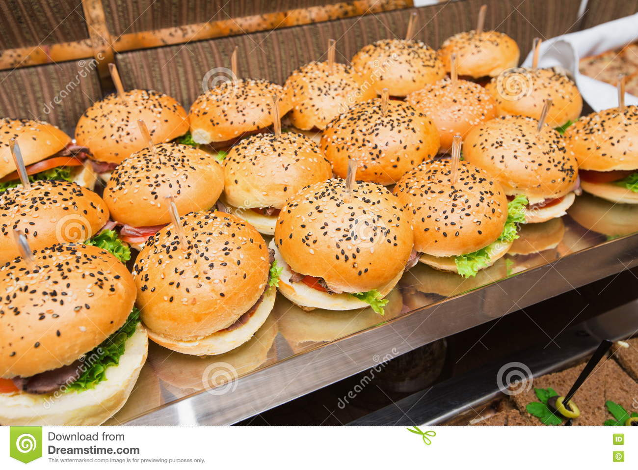 Catering at event served table with hamburgers snack for American style cuisine